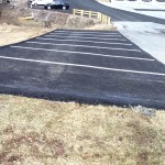 closeup of paving and line striping outside of commercial building