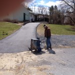 Paving Contractor preparing equipment for driveway