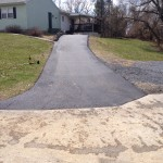 large driveway leading uphill to house