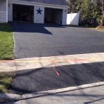 closeup of driveway taped off after paving