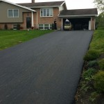 Driveway being paved by professional team