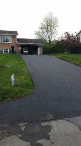 downhill driveway after paving