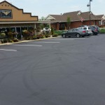 Large parking lot paved with white line striping detail