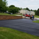 Team adding finishing touches to driveway paving job