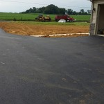 Mark's Paving crew adding finishing touches to driveway