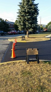 Parking lot area blocked off with cones after paving