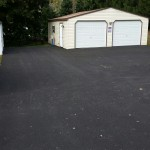 Large blacktop area around storage shed