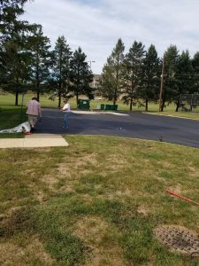 freshly laid blacktop being inspected