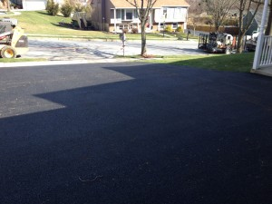 closeup of wide driveway after paving
