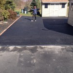 Homeowner giving thumbs up after paving job