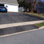 driveway paved leading up to 2 car garage