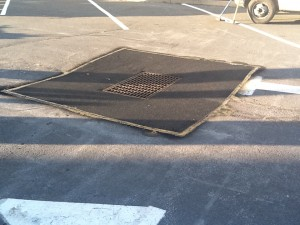 closeup of paving patch job around grate