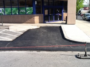 front row parking lot roped off after paving