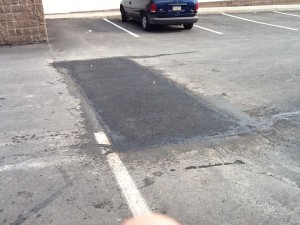 Parking lot patching over potholes
