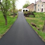 large paved driveway going uphill