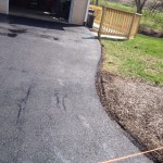 Curvy driveway paved up to garage