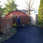 Paving contractor adding finishing touches on driveway