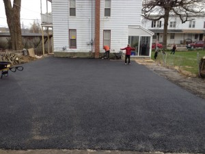wide driveway leading up to house after completion