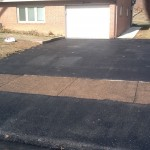 Small rectangular driveway installed outside house