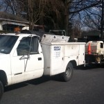 Work trucks outside of house during paving service