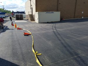 freshly laid blacktop with cones