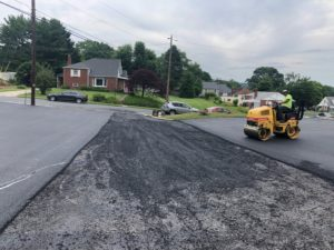 man on a roller paving asphalt