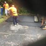 men paving lot
