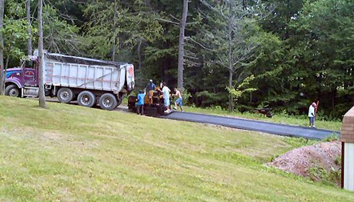 asphalt contractors paving driveway